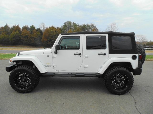 WWW.EMAUTOS.COM LIFTED ONE OWNER LIKE NEW 2013 Jeep Wrangler ...