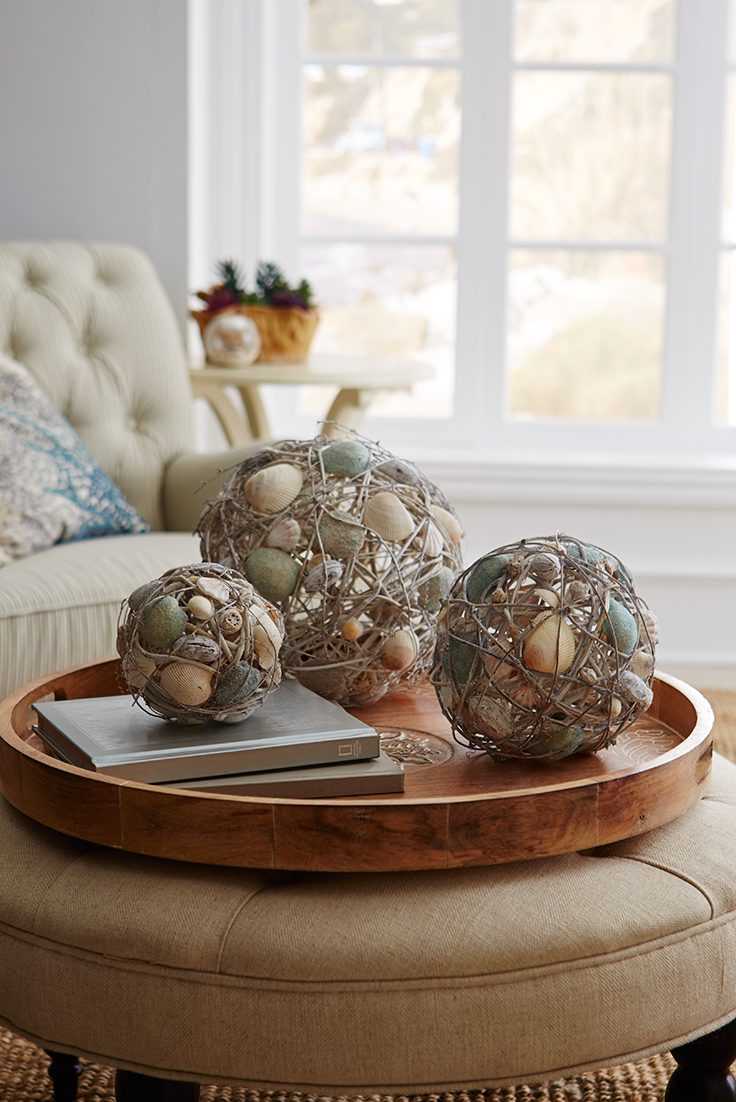 Ready to turn your home or patio into a coastal paradise? Each of Pier 1's ocean-inspired Coastal Rattan & Shell Spheres is handcrafted with natural shell pieces suspended throughout a lightweight rattan sphere. Pair them with our Abaca Rope and Moss Spheres for seaside ambience.