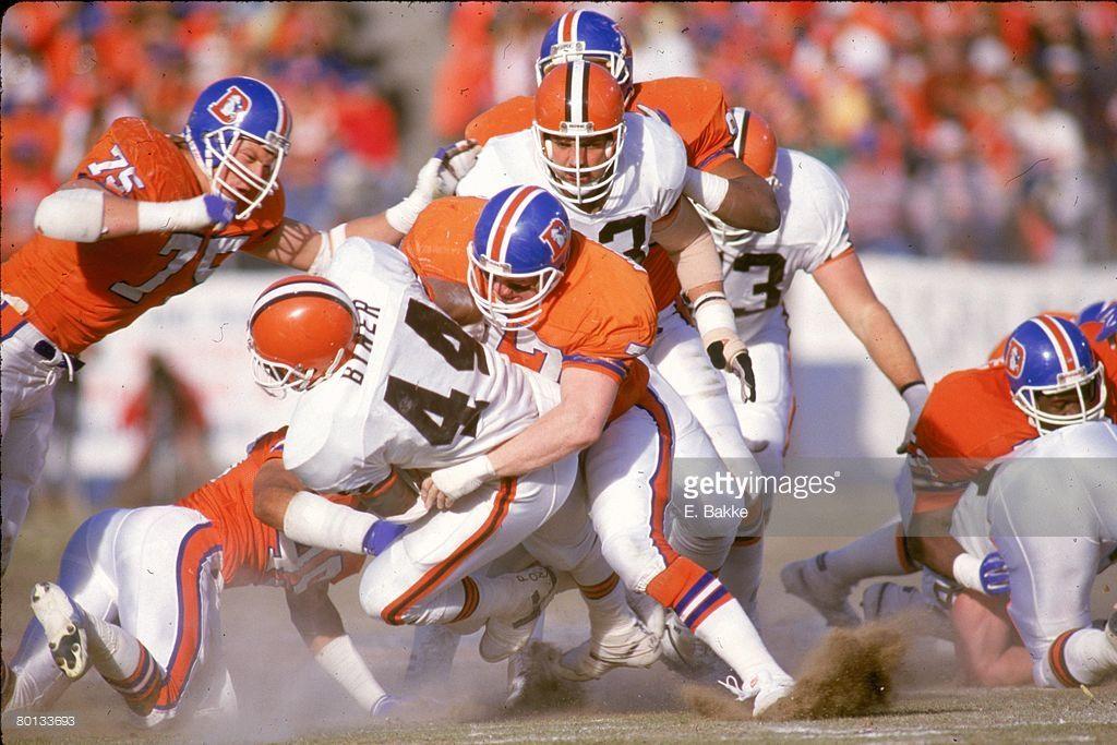 348f2bd73 Linebacker Karl Mecklenburg 77 of the Denver Broncos stops running back  Earnest Byner 44 ...