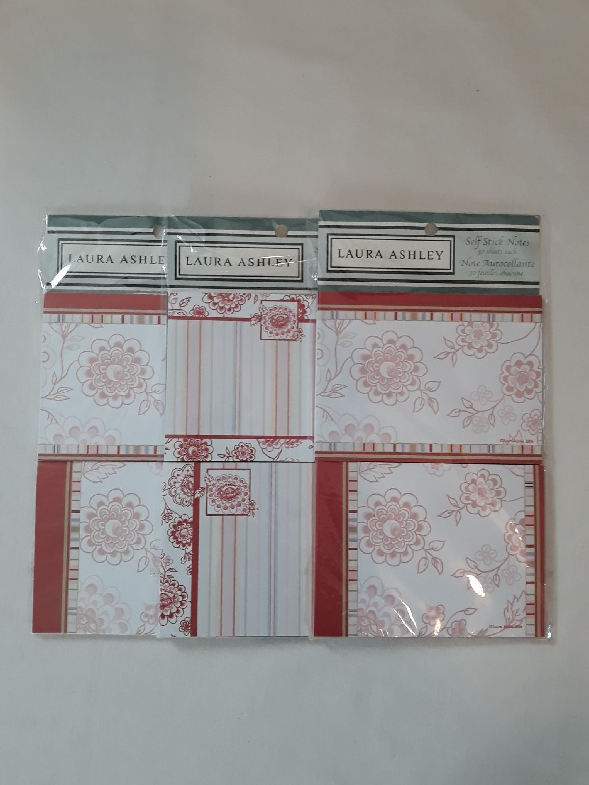 Three new, sealed packages of Laura Ashley Self Stick Notes from her 2006 stationery collection.  Each package has two note pads and each note pad has 30 sticky notes for 180 total sheets.    I am happy to combine shipping when possible on any of my items!