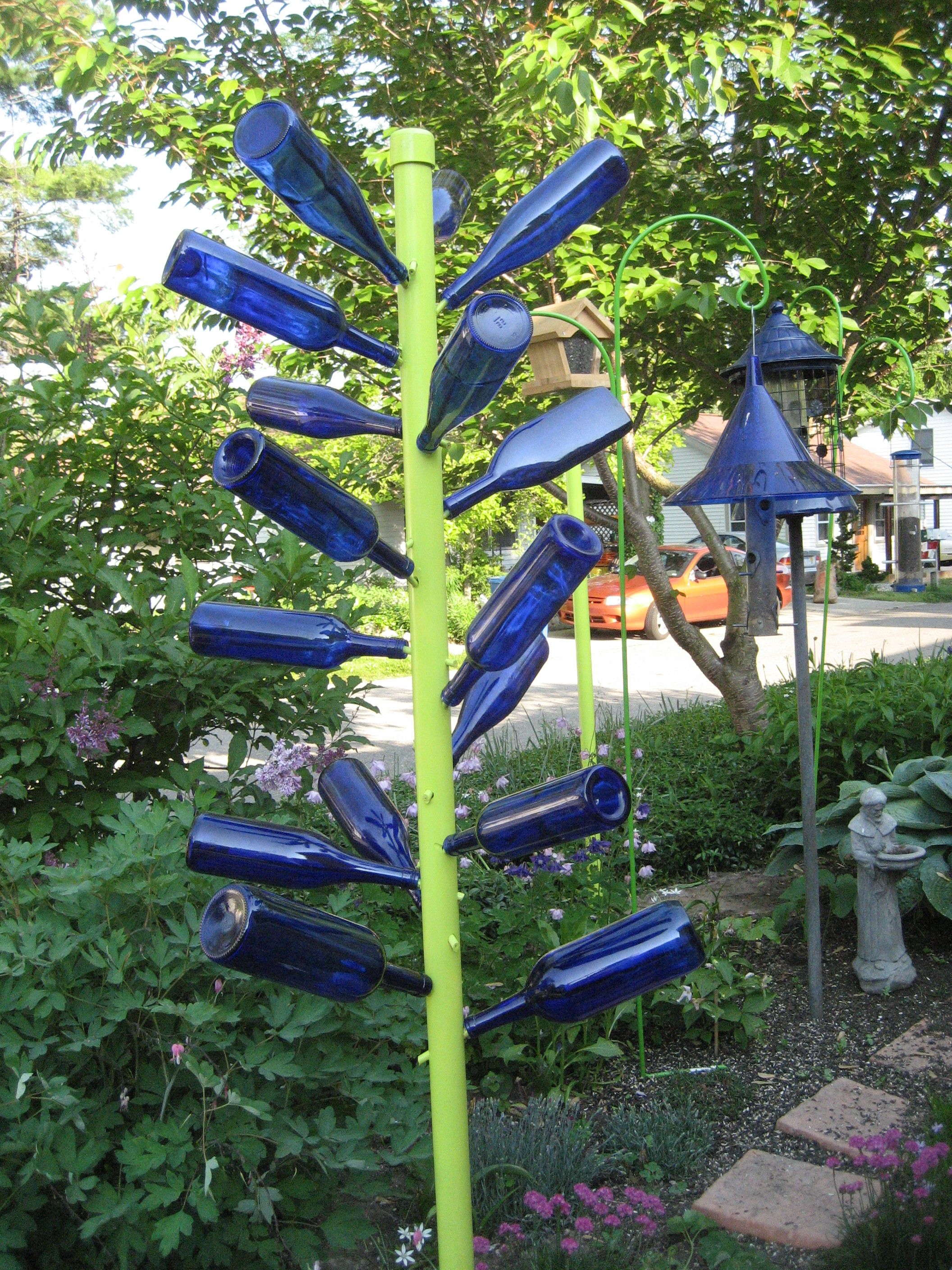 Create a bottle tree with PVC pipe, bamboo stakes and blue bottles ...