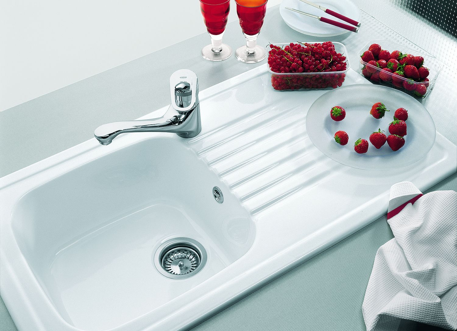 This ceramic sink has a spacious draining board to cope with the ...