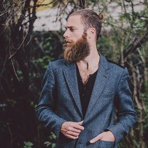 This sexy beast, who we wouldn't mind getting lost with. | 23 Beard And Man Bun Combinations That Will Awaken You Sexually