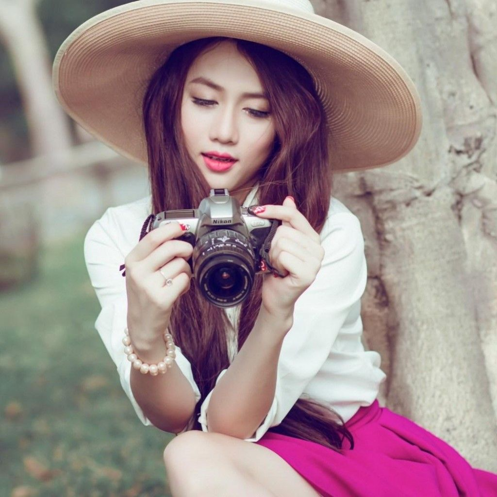 asian with camera