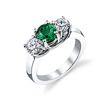 This emerald diamond engagement ring is a true classic!