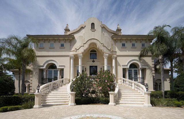 Villa Palazzo…Sicily,  Italy   Classically inspired Palladian palace. Grand entry stairs are horseshoe shaped. Limestone carved columns, balusters and trim. Stucco profiles, synthetic corbels. Custom designed column capitals and balusters
