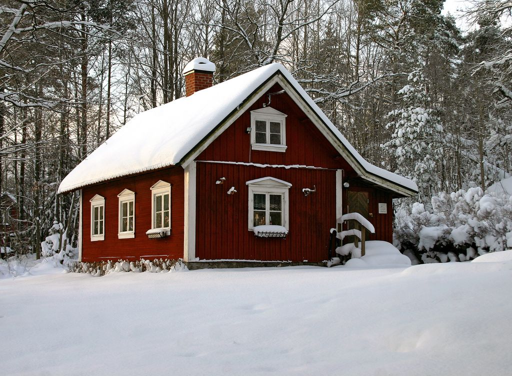 A Typical Swedish Cottage. Painted Red With The Traditional Falu Red Paint.  Today These Types Of Old Houses Are Normally Used As Summer Houses.