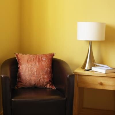 What Drapes Go With Yellow Gold Walls Brown Living Room Brown Living Room Decor Grey And Brown Living Room