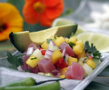 "This delicious chili and fruit flavored dish is a really great way to serve tuna. Use sashimi grade tuna because it is tender and soft-flavored. Ceviche is a slightly spiced South American dish and you can use different kinds of fish. The citrus juice ""cooks"" the fish so you have to leave it to marinate for a few hours. The fish is technically raw when you serve seafood appetizers like ceviche, but the citrus softens and flavors it. The fish is quite mild but the marinade is tangy and sharp…"