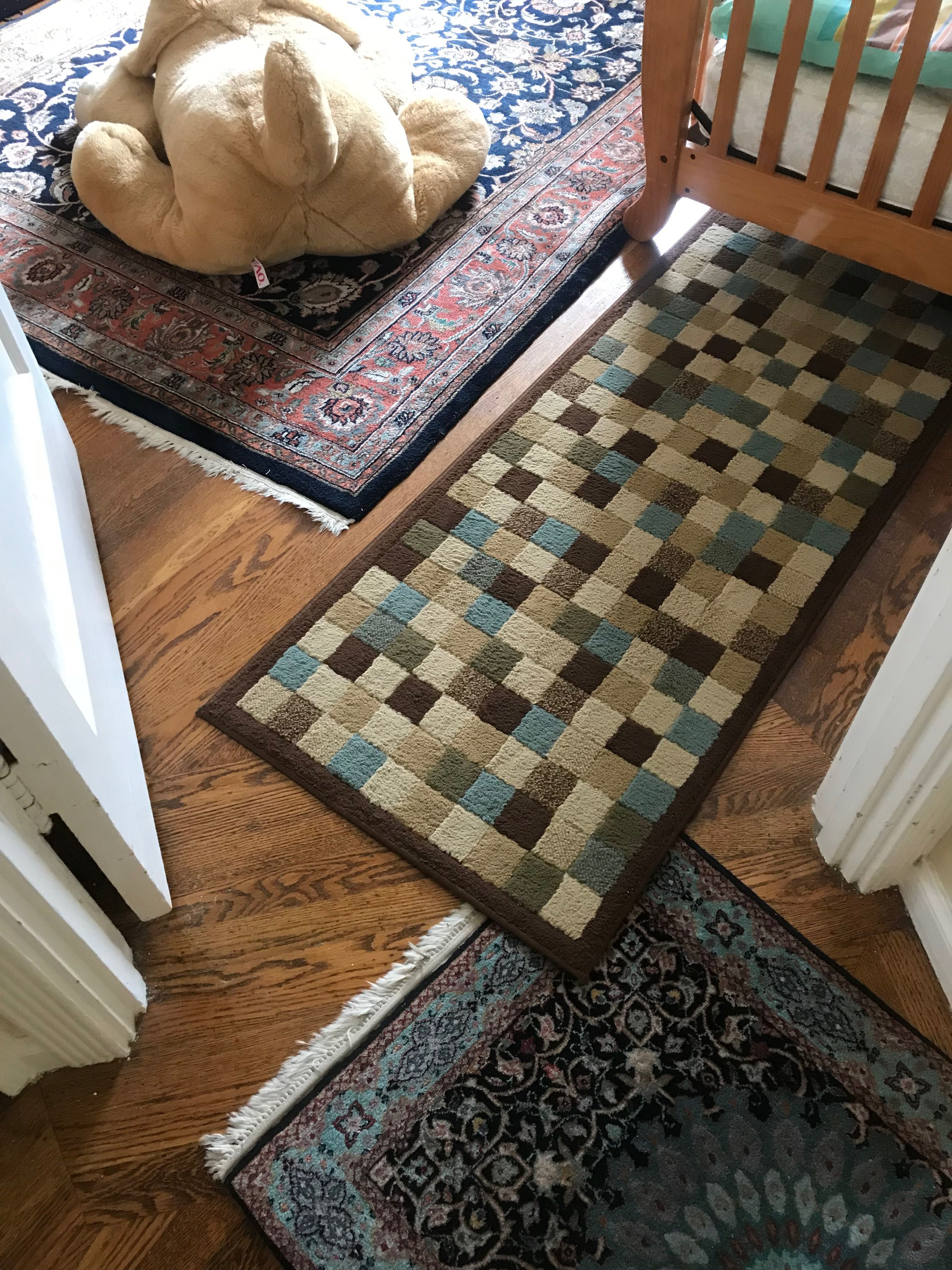 Oriental Rug And Area Rug Combined To Create Decor And Warmth In