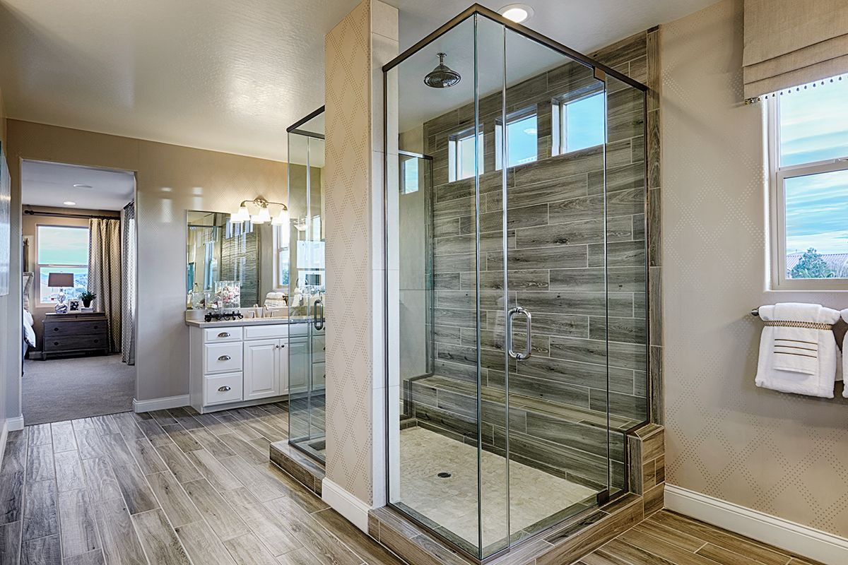 Glass Enclosed Double Sided Walk In Shower With Wood Look Tile Worth Every Hyphen Sage Model Master Bathroom Shower Bathroom Shower Doors Master Bathroom