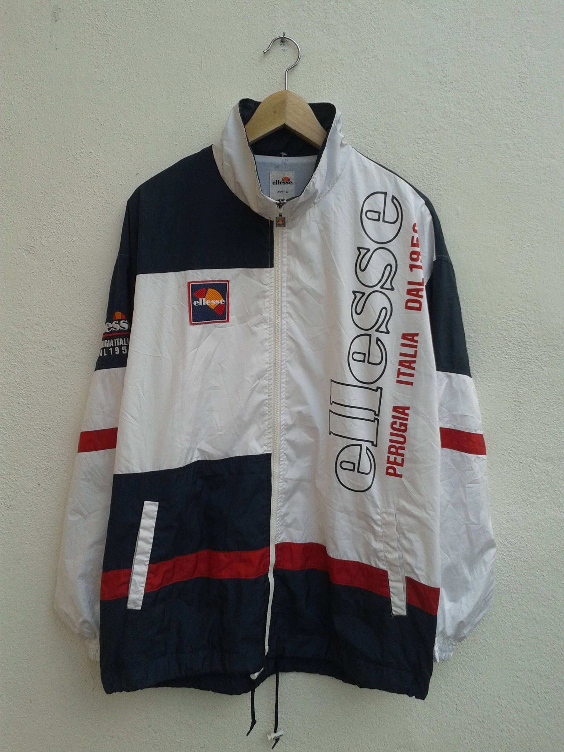 13b4184b96 Vintage 90s ELLESSE Prugia Italia Cross Color Big Spell Out Windbreaker  Sportswear Embroidered Lightweight Jacket Size L by BubaGumpBudu on Etsy
