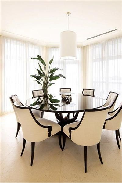 Try a circular table for your dining space! Much nicer than a ...
