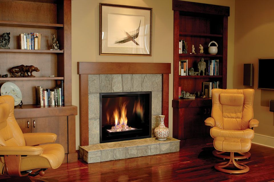 Town  Country fireplace installed in traditional-style den room