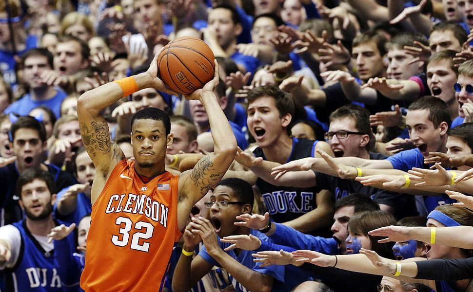 EXPLORE  FOLLOW USSHARE        Durham, N.C. — Duke fans yell as Clemson's K.J. McDaniels inbounds the ball during the first half of an NCAA college basketball game.  PHOTOGRAPH BY: GERRY BROOME / ASSOCIATED PRESS