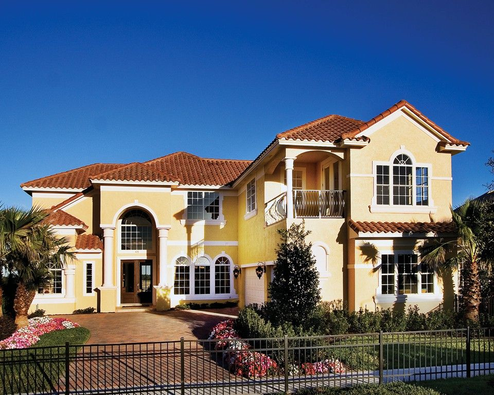 Yellow stucco house with red tile roof