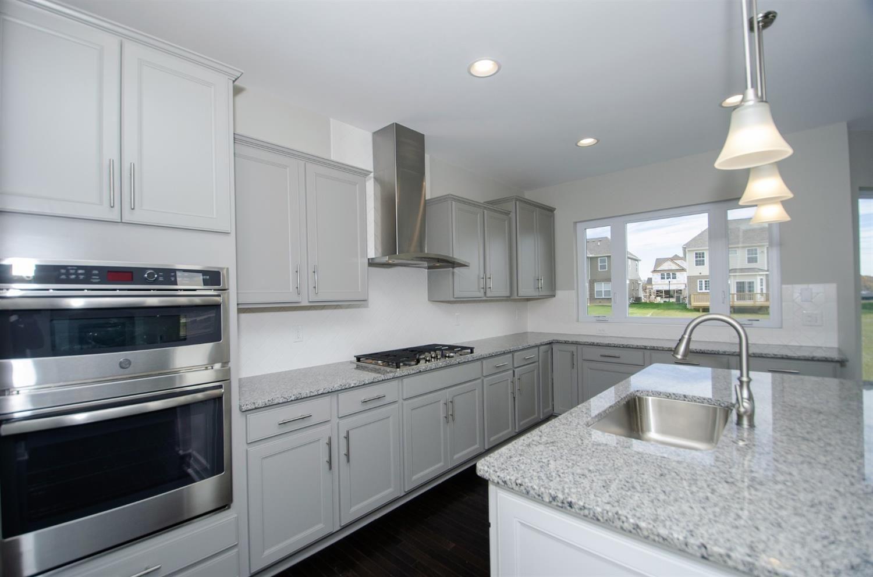 landen stone gray perimeter cabinets  stone countertops