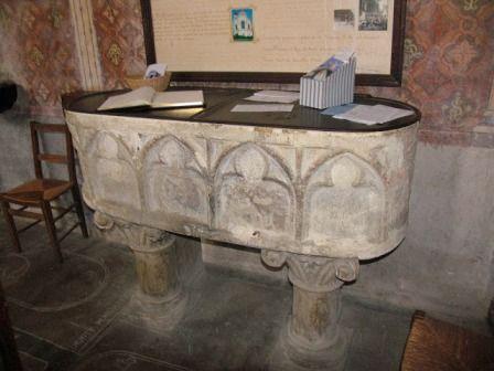 Ornate baptismal font at Notre-Dame de Rivière church