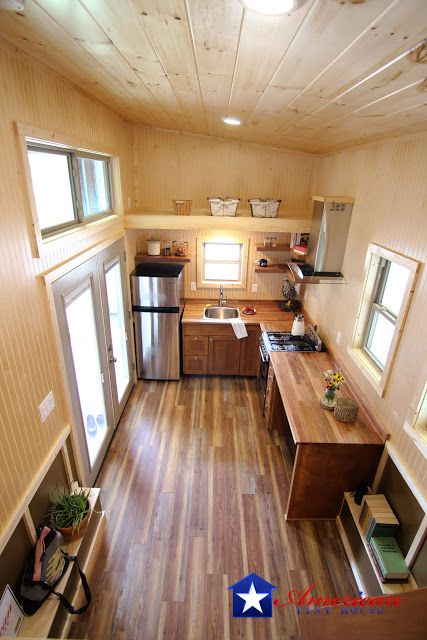 The Houston: an eye-catching 28\' tiny house on wheels with a cozy ...