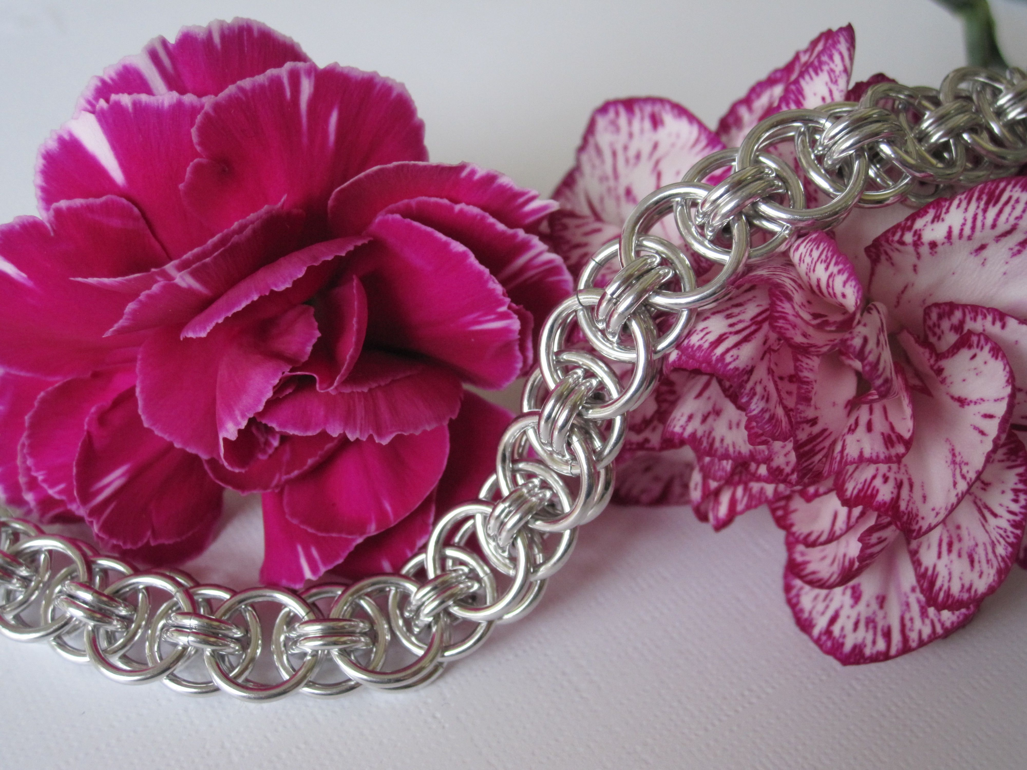 I love this weave; have made a bracelet using gold rings as well as silver.  Feels very silky.