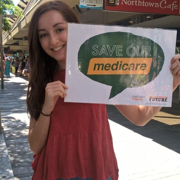 Townsville markets ... this young lady is studying Medicine at JCU. Medicare ... not credit card care is good for your health.