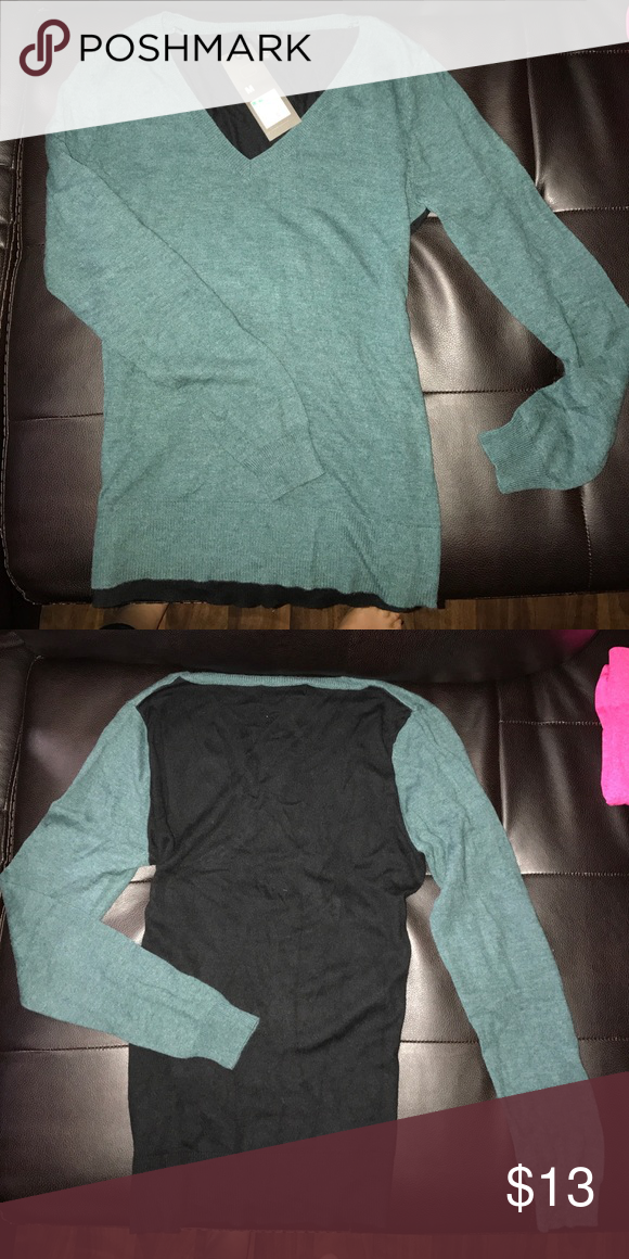 Teal/Black Sweater Woman's Medium size sweater with tag still attached. Front is teal and the back is black. Sweaters V-Necks