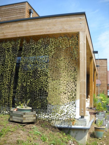 Utiliser des filets de camouflage comme des rideaux Pergolas