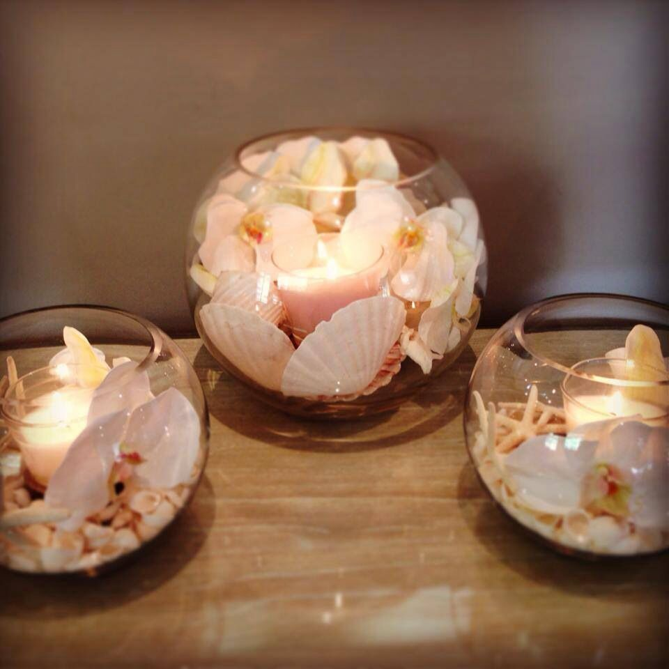Fishbowl with shells and candle - when love sparks
