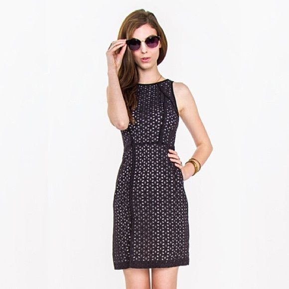 Lucia Eyelet Dress A gorgeous black eyelet dress. Features piping in the front and back for a cool structured detail. Invisible zipper closure on back. Also features a side slit to show some leg. Looks cute paired with black pumps for a dinner date.  100% Cotton Hand Wash Only Dresses Midi