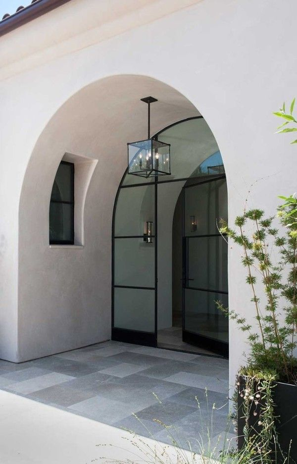 Contemporary Entryway Light Fixtures Using Hanging Outdoor Lanterns With Candle Shaped Bulbs Also Large Concrete Planters