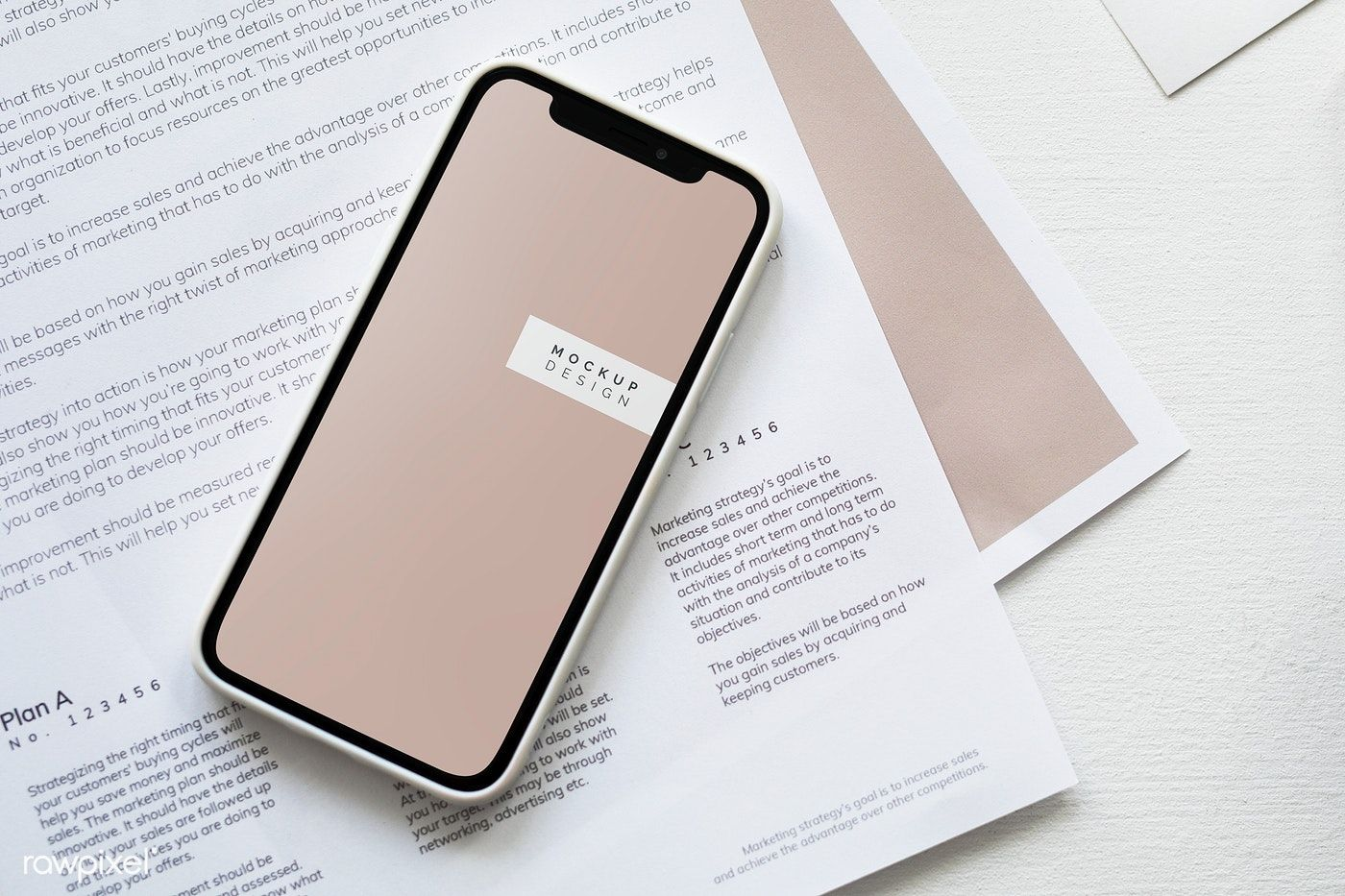 Download premium psd of Mobile phone mockup on a paper