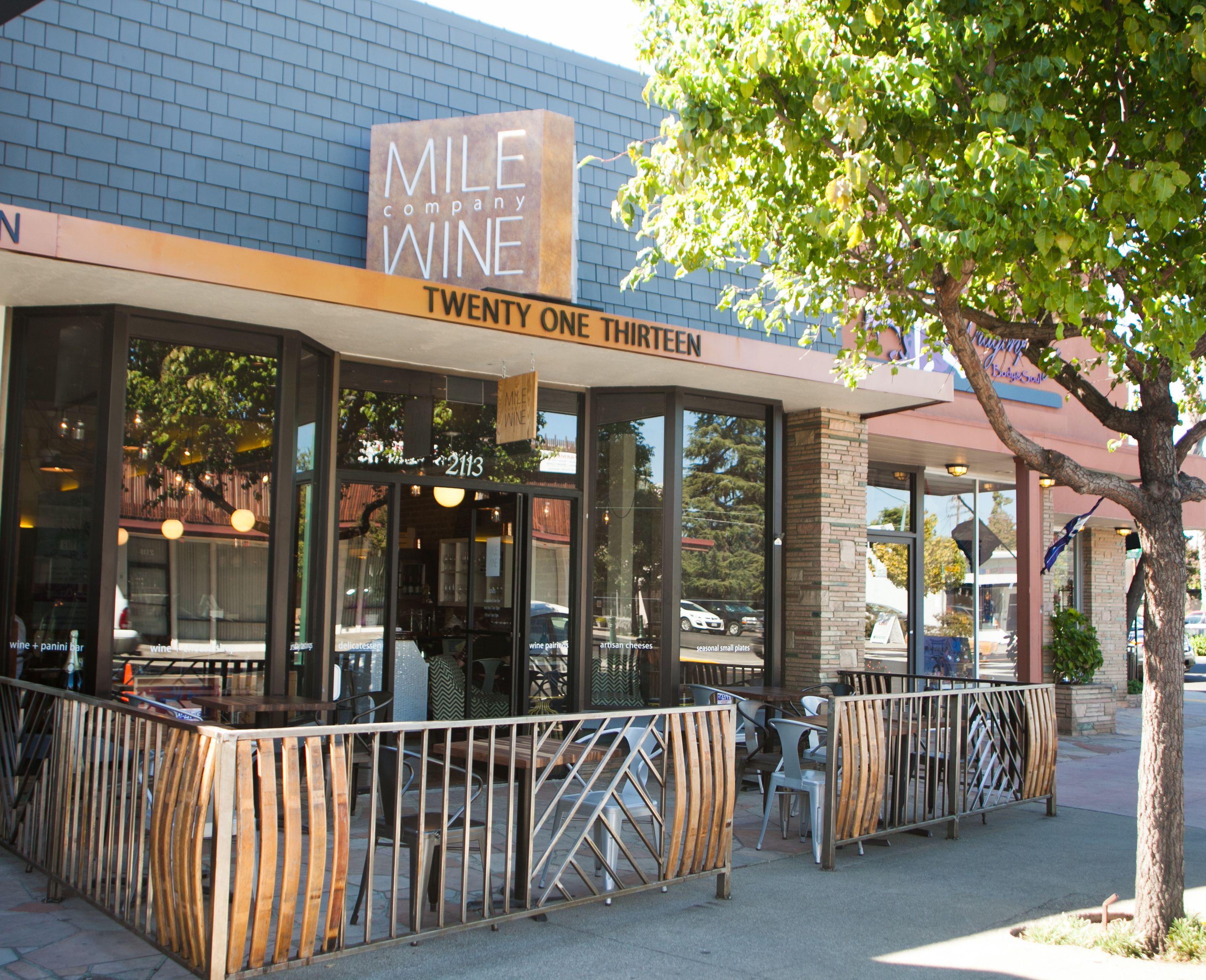 Facade, sidewalk seating, wine barrel stave fence, signage