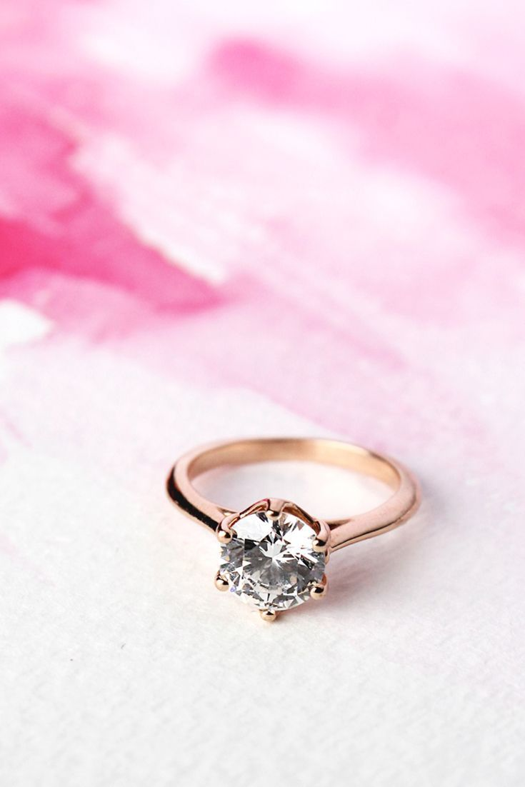 A six-prong solitaire in rose gold is a romantic and modern take on ...