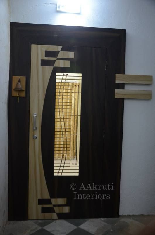 Safety door at thakur complex kandivli aakruti interiors for Office main door design