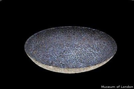 """Roman Glass Bowl Unearthed At Ancient London Cemetery - Archaeologists have discovered a Roman glass bowl at an ancient cemetery outside the walls of the old city of London.    The """"millefiori"""" dish is a mosaic of hundreds of indented blue petals with white bordering, and is believed to be a rare find in the Western Roman Empire. It is estimated to date from around 2nd to 3rd century A.D."""