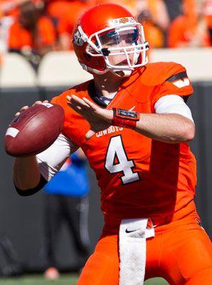 Oklahoma State in throwback orange helmets   Osu cowboys