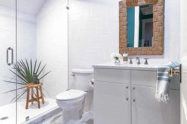 Located On The Second Floor Of This Scenic Coastal Retreat The Mostly White Guest Bathroom One Has Teal Hu In 2020 Hgtv Dream Home Bathroom Design Tool Guest Bathroom