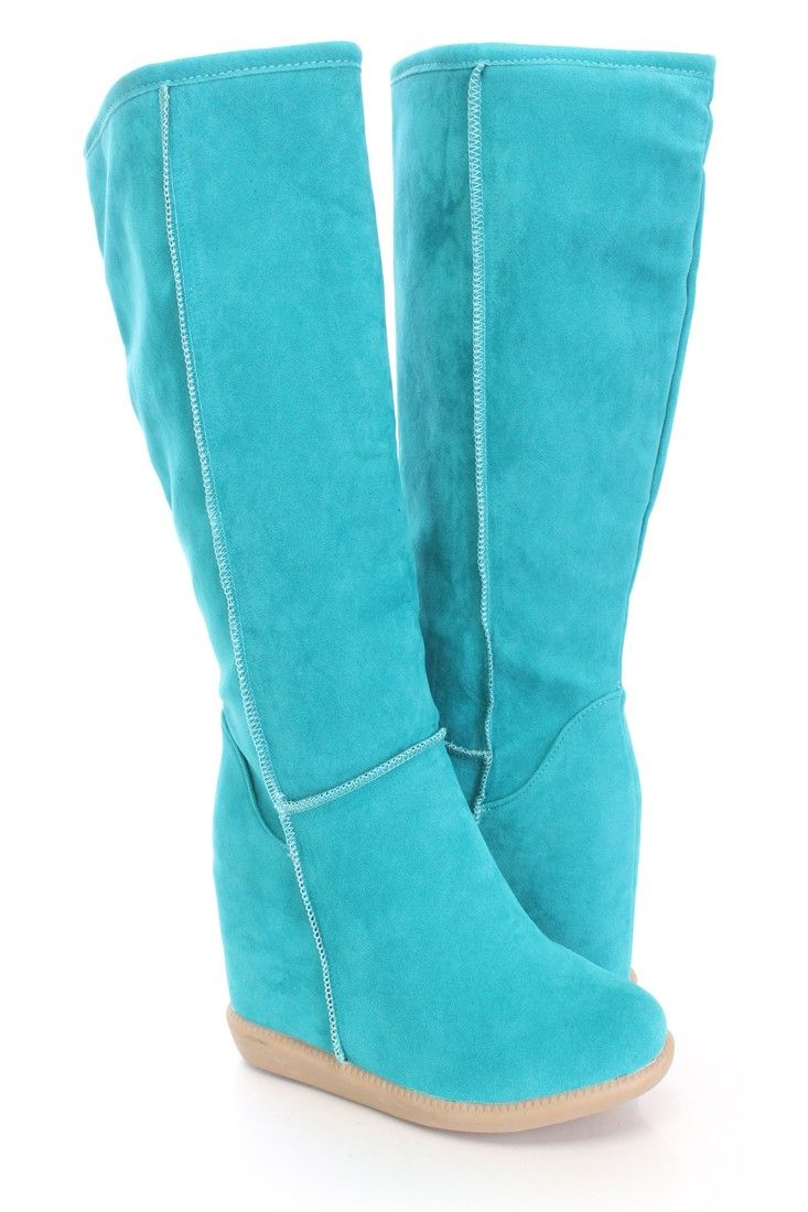 Be comfy yet stylish this season with these fashionable wedge boots! They will go perfect with your favorite dress or skinnies! Make sure you add these to your closet, it definitely is a must have! The features include a faux suede upper with a round closed toe, stitched detailing, hidden wedge, smooth lining, and cushioned footbed. Approximately 3 1/2 inch hidden wedge heels, 15 1/2 inch circumference, and 13 inch shaft.