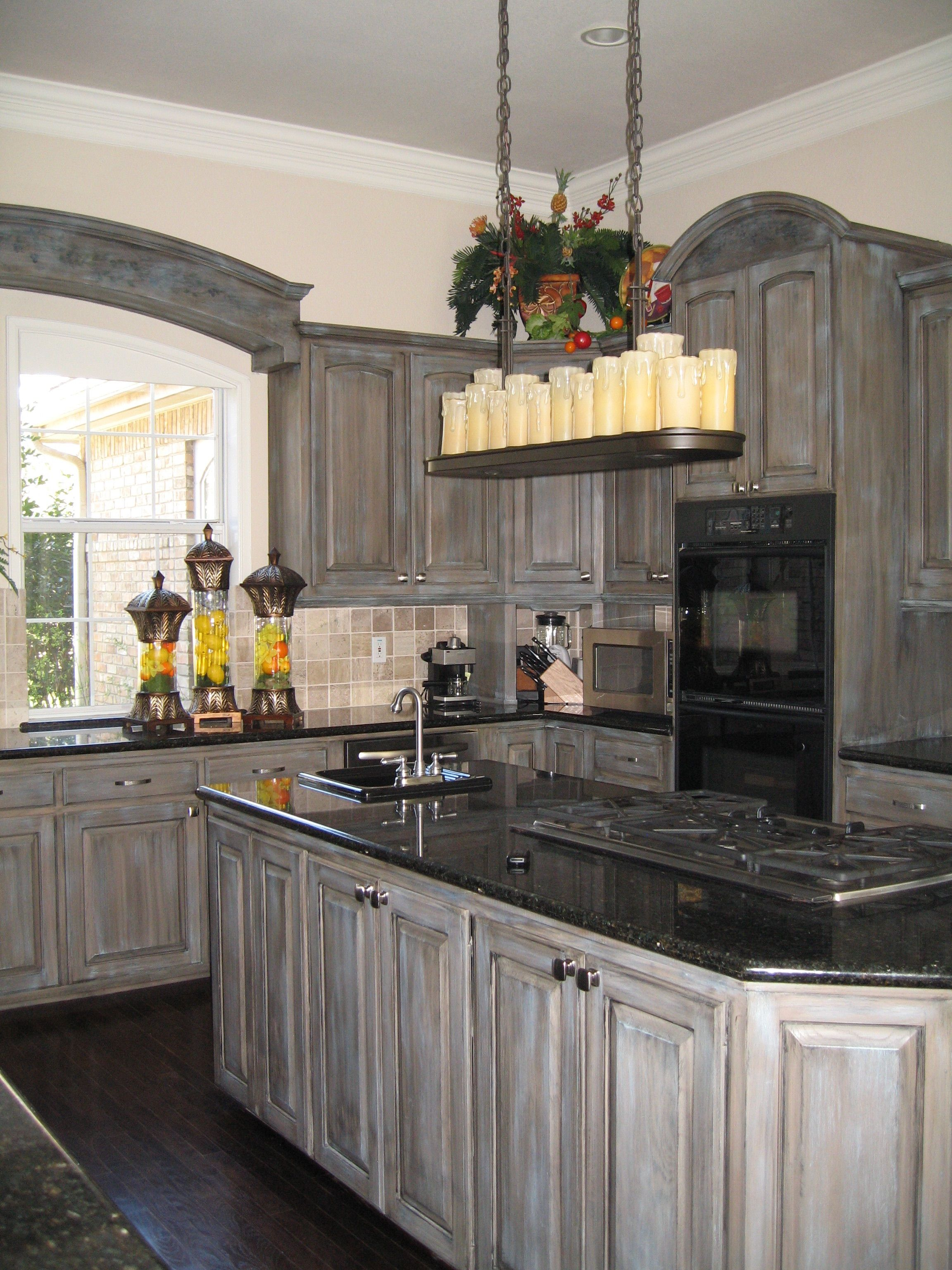 Glaze added a touch of blue to these gray stained cabinets ...