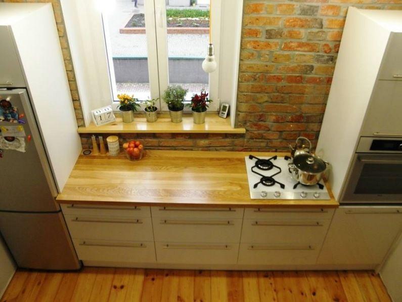 Biala Kuchnia Z Drewnianym Blatem Na Tle Czerwonych Cegiel Lovingit Pl Home Decor Kitchen Kitchen Cabinets