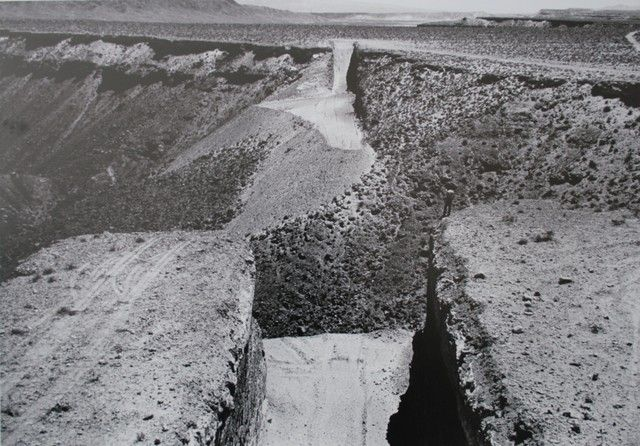 Michael Heizer . double negative  Nevada . 1969   comprises two giant rectangular cuts (and the space in between them) in the irregular cliff edges of a tall desert mesa near Overton, Nevada.