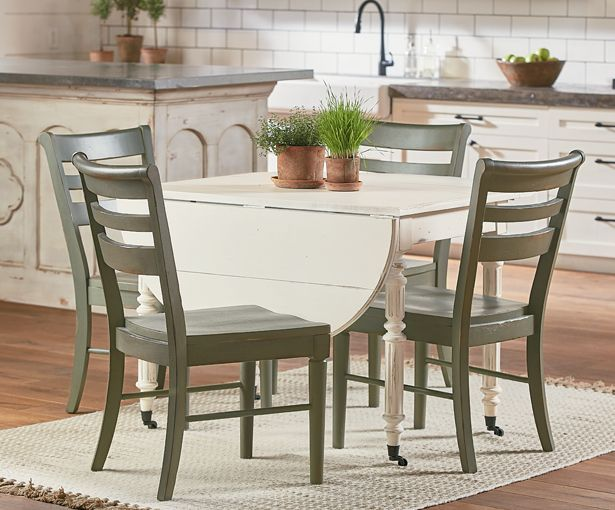 From The New Magnolia Home Furnishings Line By Joanna Gaines Select Items At The Great Ame Oval Table Dining White Oval Dining Table Magnolia Home Furnishings