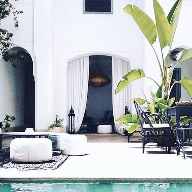 Insert me here. Weekend dreaming... I need more Moroccan ottomans in my life. #inspo #white #gypsetlife #villa #living #tropics #thebeachpeople via @museinspirations