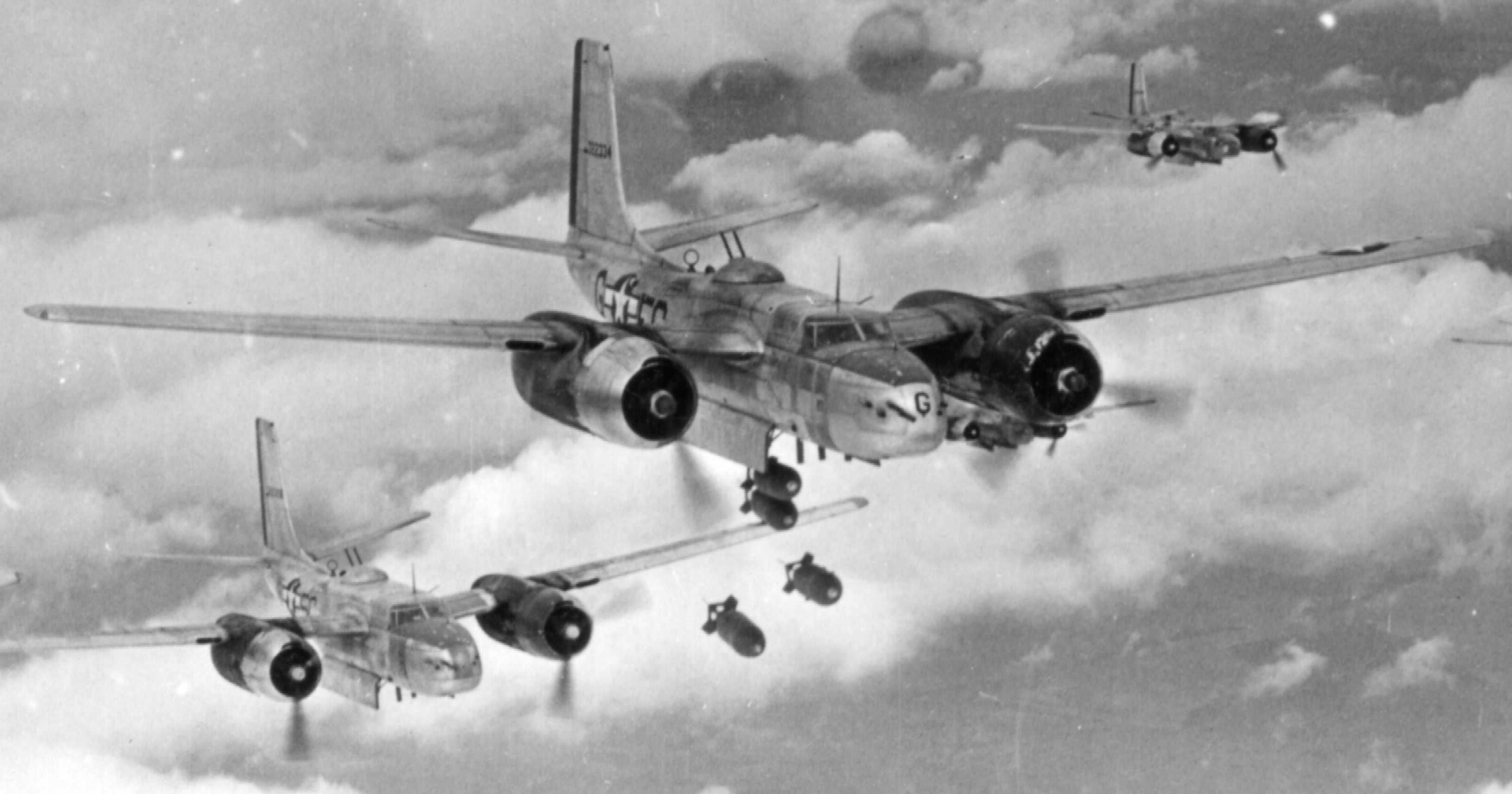 US 416th Bombardment Group Douglas A-26 bombers begin bomb drop over German positions Dec 1944-Jan 1945. The A-26 served through the Korean War and, in highly modified form, remained in limited service until 1969.
