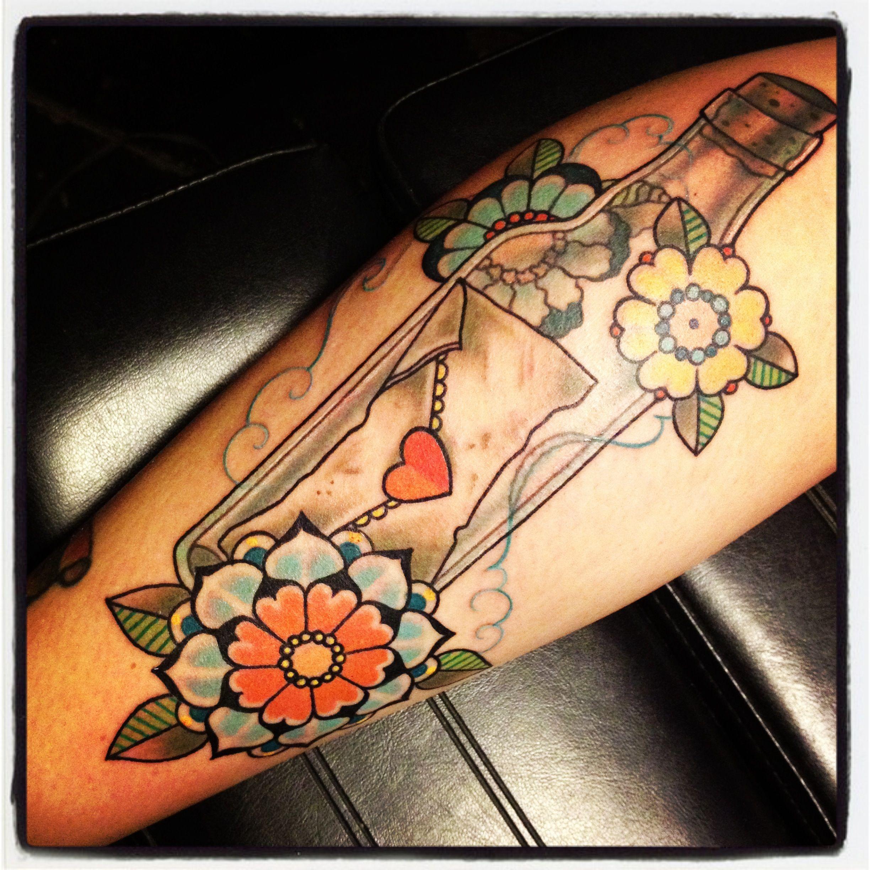 Message in a bottle tattoo done by Noelle LaMonica in West