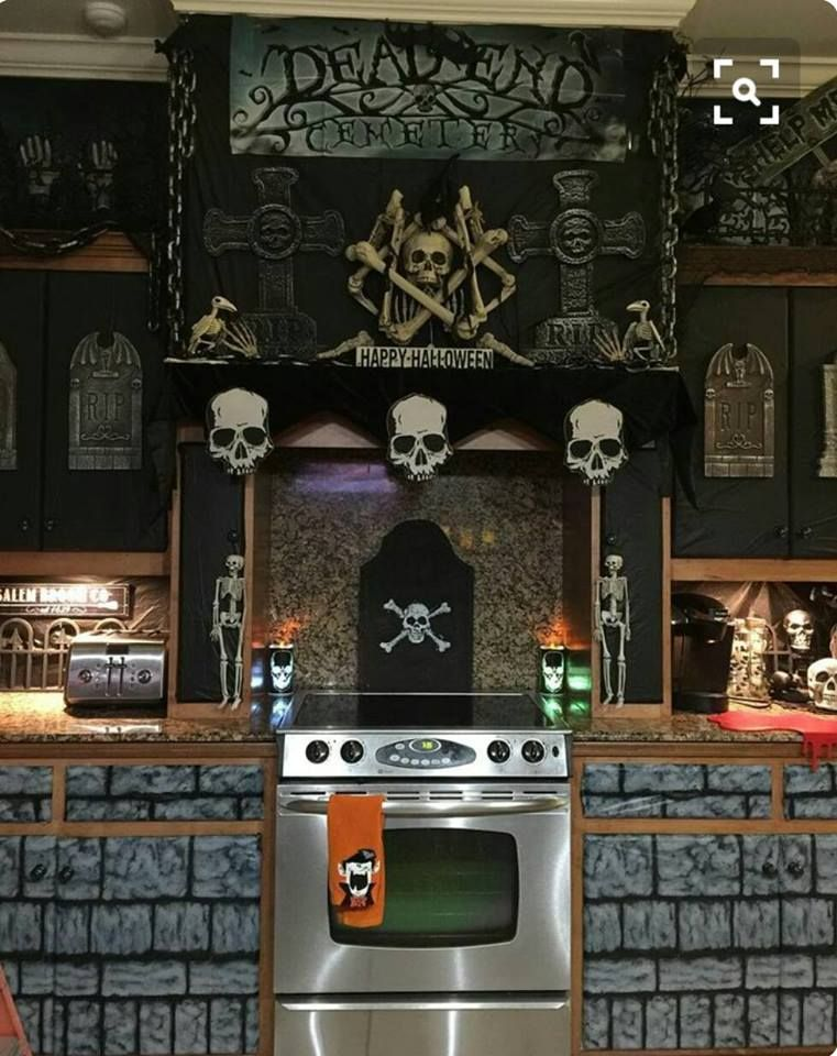 Cool (and cheap) way to decorate a kitchen using the black weed - halloween scene setters decorations