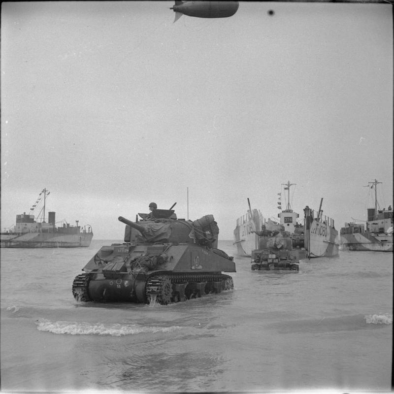 Sherman tanks driving ashore from landing craft during