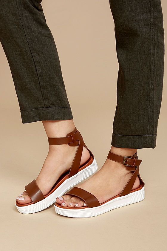 22c44a14737 You couldn t find a cooler sandal than the Mia Ellen Cognac Flatform Sandals  if you went to Mars and back! Brown vegan leather forms a toe strap and ...