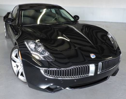 The Fisker Karma Is Loser In Battle With Tesla For Electric Vs Hybrid American Made Cars Car Stunning And It Has A Gas Motor Generator To