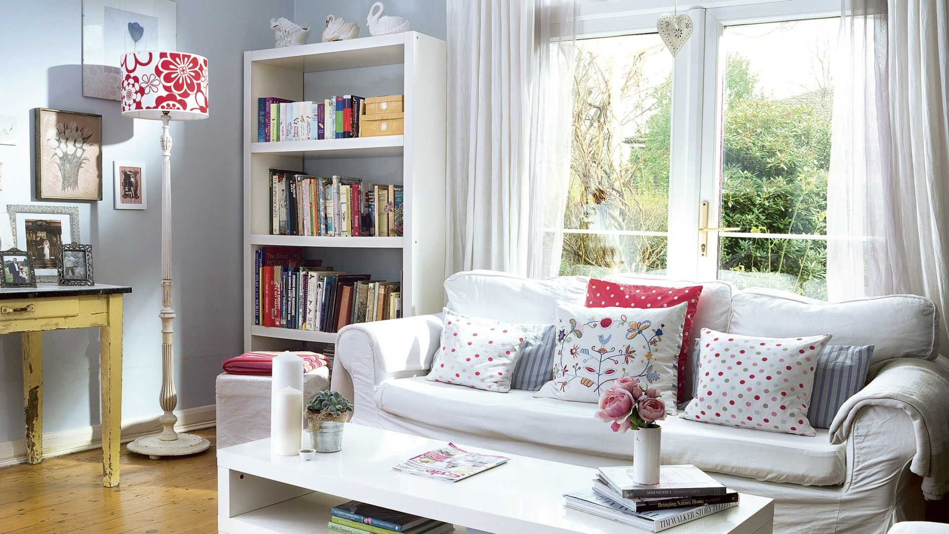 Light and bright country living room with colourful cushions ...